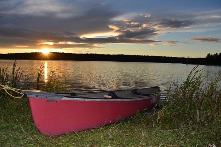 canoe-beside-lake